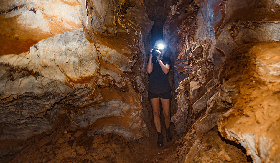 Guest in a passage of the 2.5 km long passage system of the Ghaub Cave